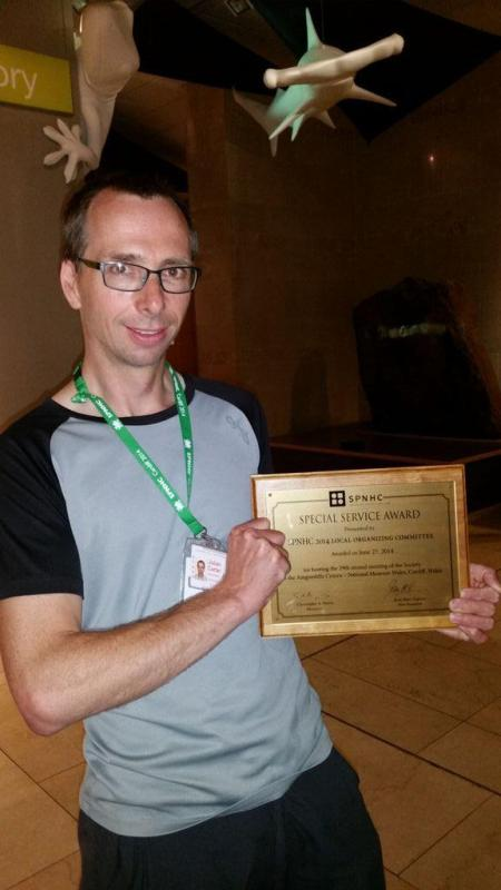 Jules receiving the Special Service Award at SPNHC2014