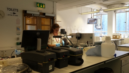 Vicky Singleton,  Conservator at Cambridge University Museums  pictured demonstrating dry cleaning methods (Image: Anthony Roach)